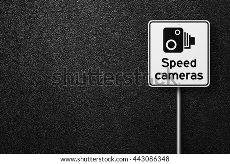 Road signs. Behind the signs one can see a smooth asphalt road. Speed limit. Speed-limit cameras. The texture of the tarmac, top view. - stock photo