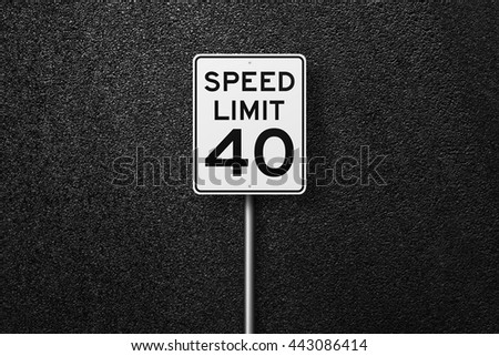 Road signs. Behind the signs one can see a smooth asphalt road. Speed limit. The texture of the tarmac, top view. - stock photo