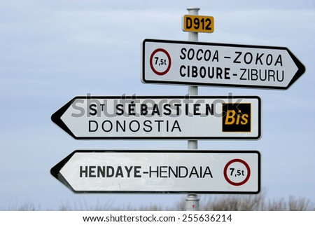 Road signs in the Basque Country that borders Spain and France point to various towns in the area. - stock photo