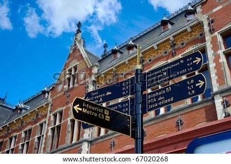 Road signs of Amsterdam central railway station,Holland - stock photo