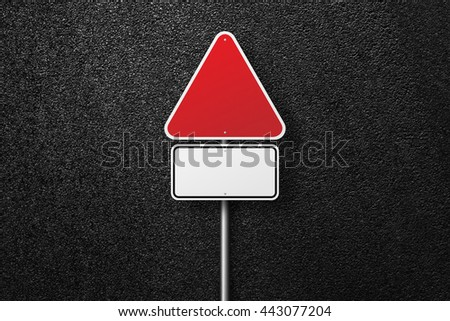 Road signs of the triangular shape. Blank road signs. Behind the signs one can see a smooth asphalt road. The texture of the tarmac, top view. - stock photo