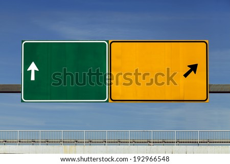 Road signs over overpass - stock photo