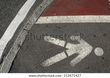 road signs: painted signs on asphalt for pedestrian lane