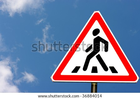 road signs; pedestrian crossing stripes on the blue sky - stock photo