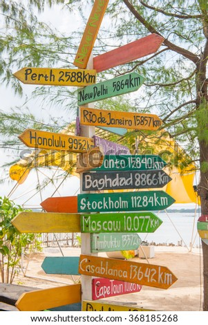Road signs pointing towards different cities, stock picture - stock photo