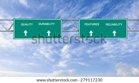 Road signs to quality; features; reliabilitiy;  durability - stock photo