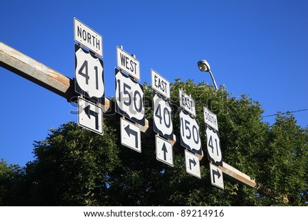 Road Signs - U.S. Highway signs in point in different directions. - stock photo