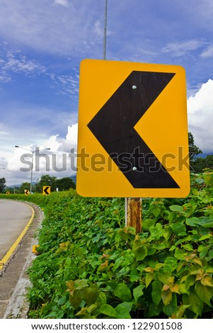 Road Signs warn Drivers for Ahead Dangerous Curve. - stock photo
