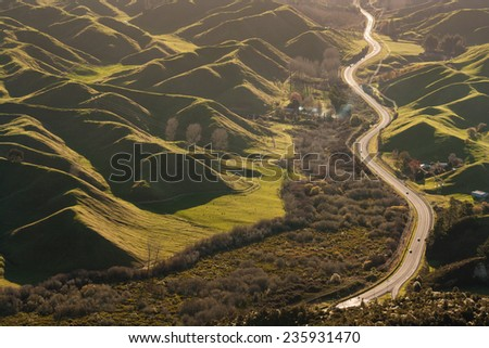 road snaking amongst volcanic hills in Rotorua, New Zealand - stock photo