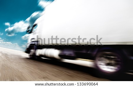 road speed. Trucks delivering merchandise - stock photo