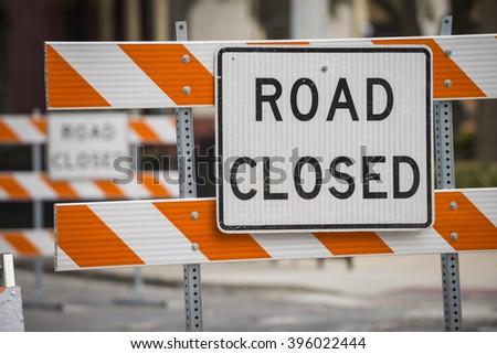 Road street construction zone warning hazard sign road closed - stock photo