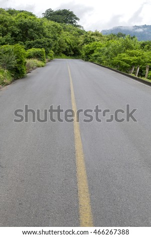 Road surrounded by mountains and nature