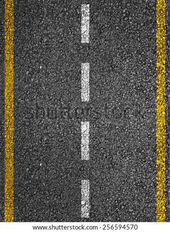 Road texture with two yellow stripes and dashed white stripe - stock photo