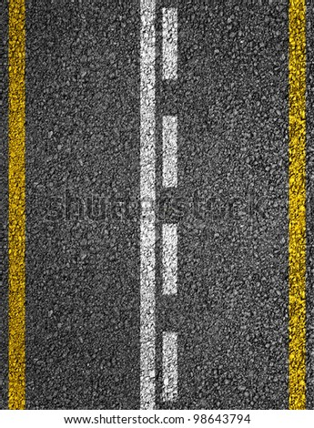 Road texture with white and yellow stripes - stock photo