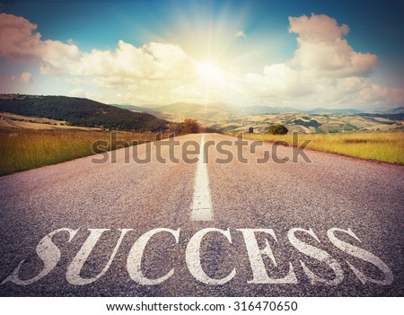 Road that says success in the asphalt - stock photo