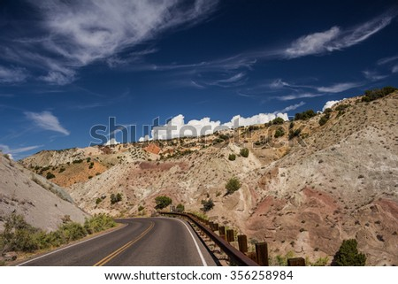 Road Though a Rocky Landscape with a Blue Sky  - stock photo