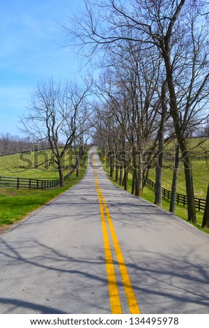 Road through Kentucky's Horse Country during the Springtime - stock photo