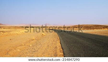 Road through Namib desert in Namibia - stock photo