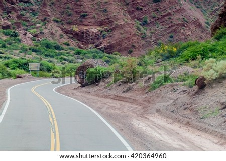 Road through Quebrada de Cafayate valley, which is full of colorful rock formations, northern Argentina. - stock photo