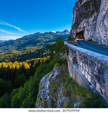 Road through rock to Passo Falzarego, Dolomites - stock photo