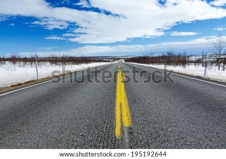 Road through Scandinavian tundra - stock photo