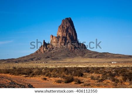 Road through Southwestern Landscape of dry, stony land - stock photo