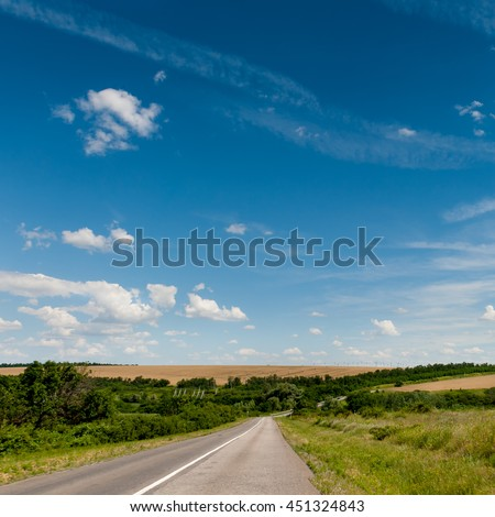 Road through the hills in summer day