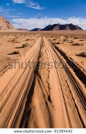 Road through the sands of the Wadi Rum desert in Jordan - stock photo
