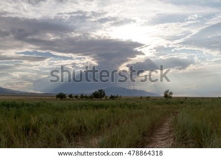 road through the steppe to the mountains