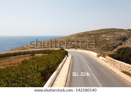 Road to Azure Window, famous stone arch of Gozo island in the sun in summer, Malta - stock photo