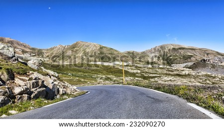 Road to Col de la Bonette located in the South Alpes in France. It is one of the highest asphalted road in Europe. - stock photo