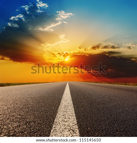 road to dramatic sunset - stock photo