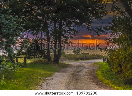Road to fishermen village at dawn, beach of the Baltic Sea, Latvia, Europe - stock photo
