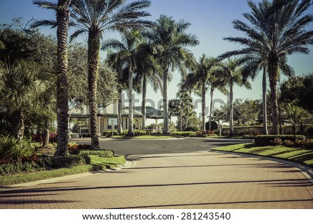Road to gated community in South Florida - stock photo