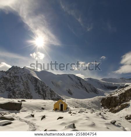 Road to high altitude mountain shelter in a snow valley, Altai mountains, Siberia - stock photo