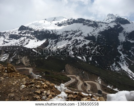 Road to hill top of Yumesamdong (Zero Point) in Lachung, North Sikkim.  - stock photo