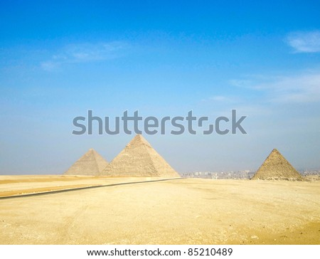 road to pyramids Giza in background of blue sky and Cairo, Egypt - stock photo