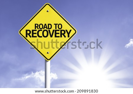 Road To Recovery road sign with sun background  - stock photo