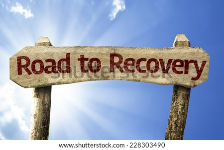 Road to Recovery wooden sign on a summer day - stock photo