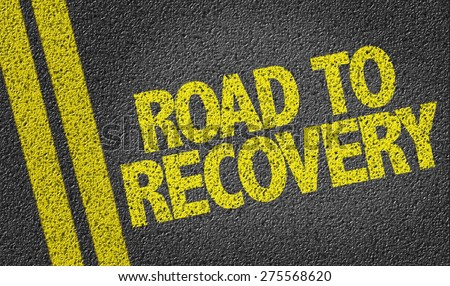 Road to Recovery written on the road - stock photo
