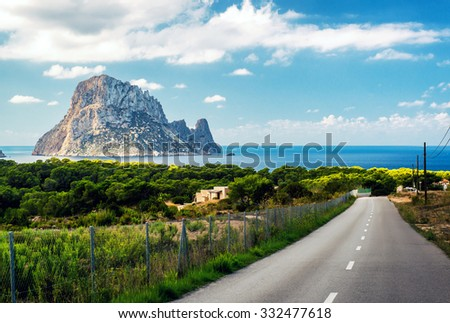 Road to the Cala d'Hort beach. Cala d'Hort is a small, beloved beach with a fantastic view of the mysterious island of Es Vedra. Ibiza, Balearic Islands. Spain - stock photo