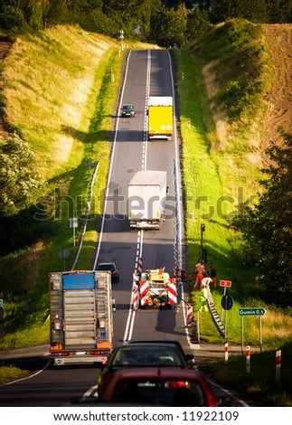 Road to the hill. Contrast colors. - stock photo