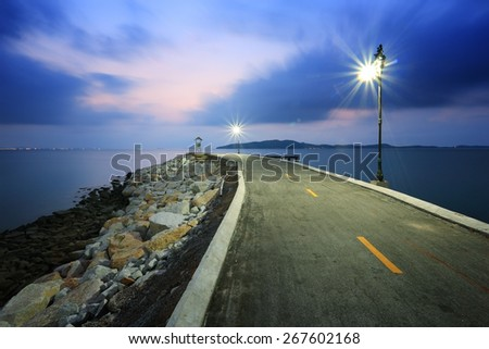 Road to the sea at twilight - stock photo