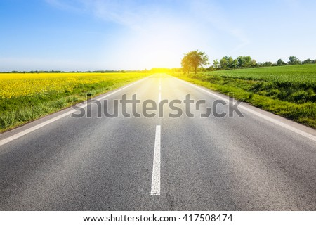 Road to the sun. Beautiful yellow field countryside landscape