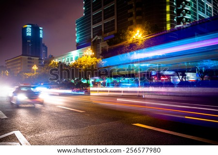 Road traffic at night - stock photo