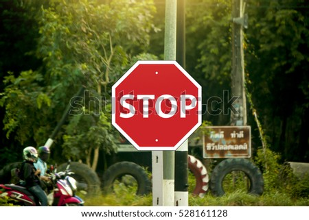 Road traffic signs say stop waiting.