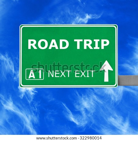 ROAD TRIP road sign against clear blue sky - stock photo