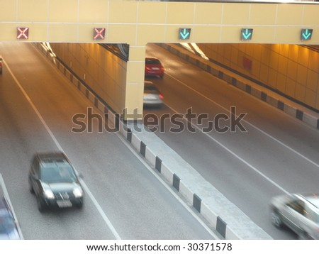 road tunnel under bridge at day