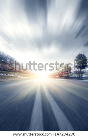 road under blue sky motion blur - stock photo