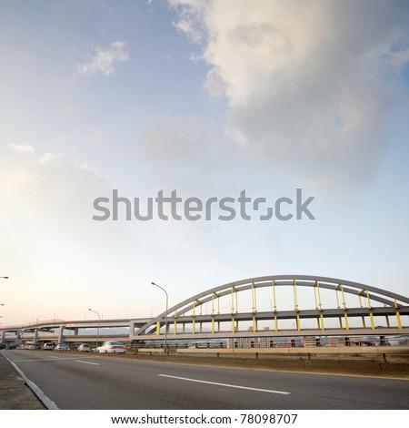 Road under sky with bridge far away in Taipei, Taiwan, Asia. - stock photo